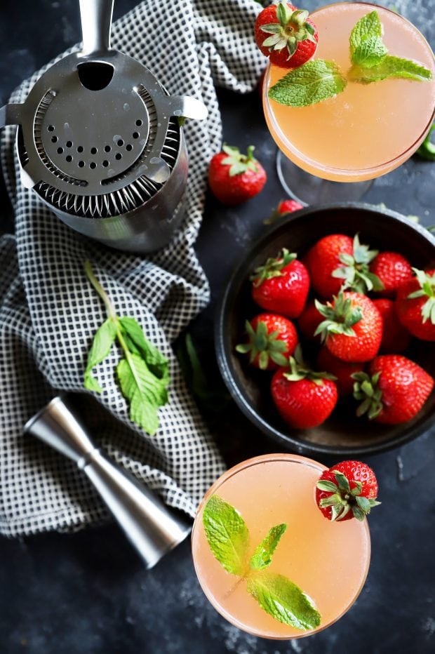 Overhead image of cocktails, berries, and mint