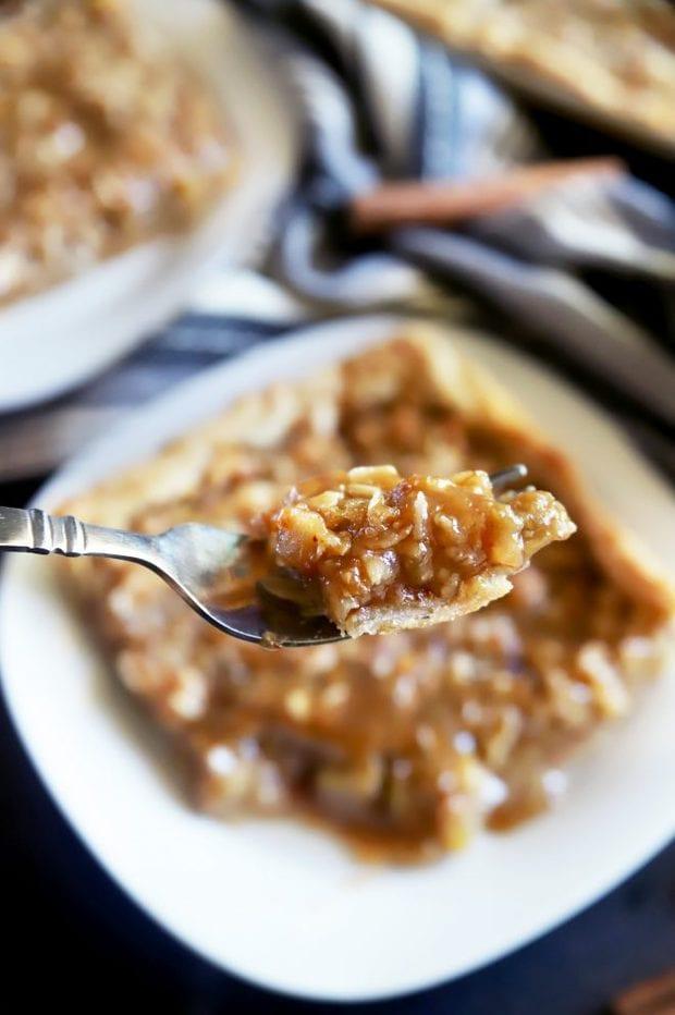 Fork full of homemade apple pie