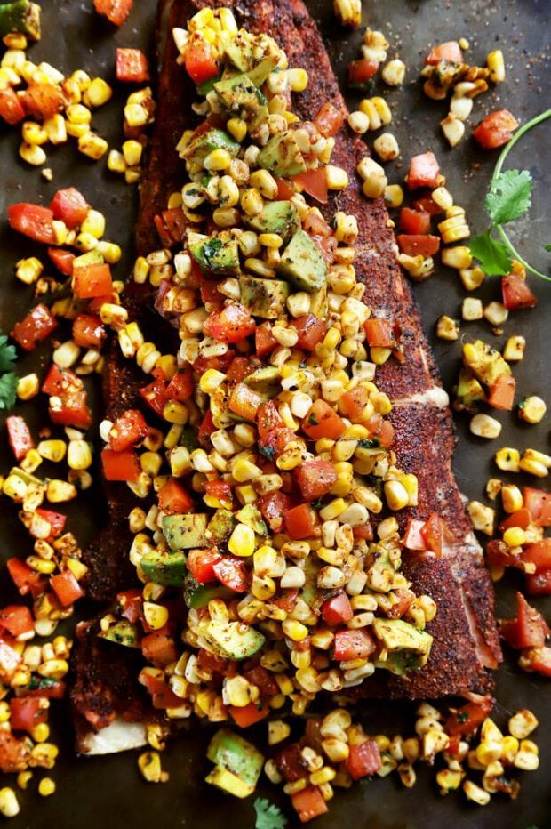 Overhead shot of grilled salmon with corn salsa
