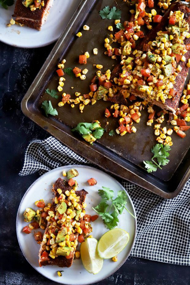 Salmon for dinner on a plate with charred corn salsa