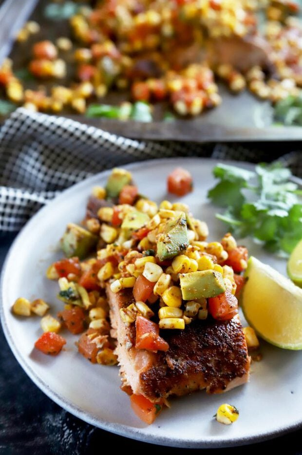 Corn salsa on top of a salmon filet