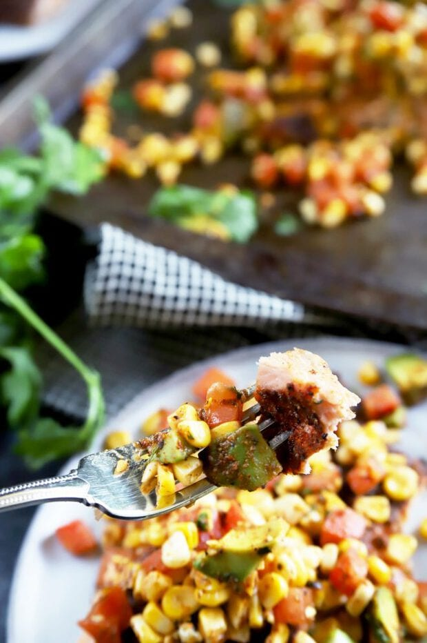 Fork full of salmon with corn salsa