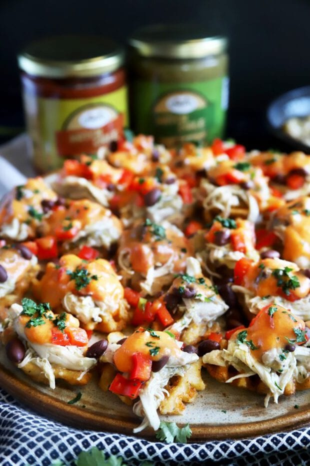 Photograph of bite-sized chicken nachos on a platter