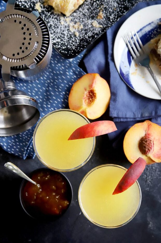 Overhead photo of peach breakfast martinis with peach slices