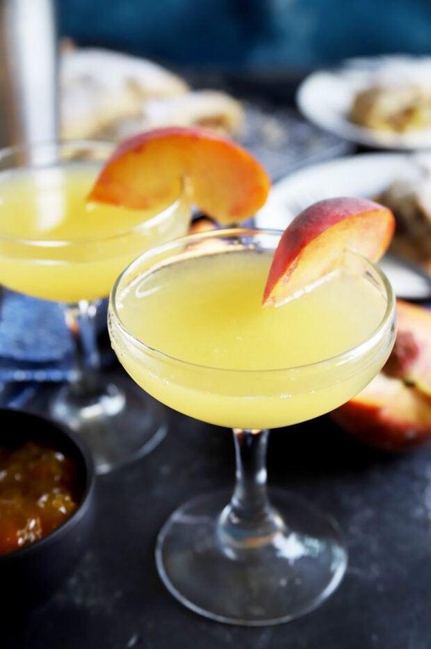 Peach breakfast martini with peach slices