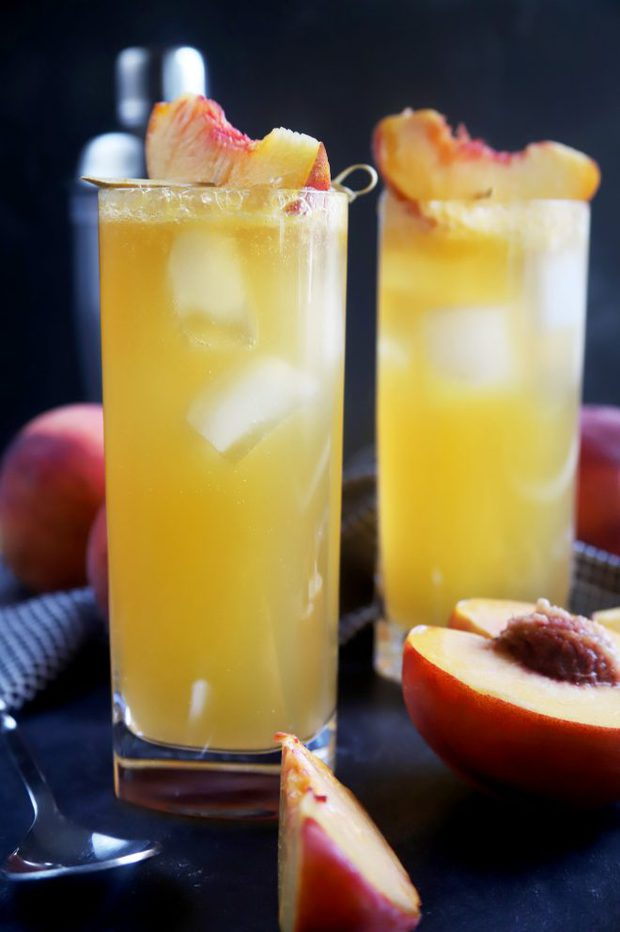 Side shot of two peach highball cocktails