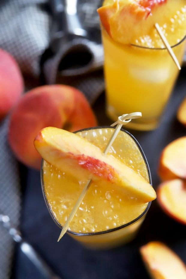 Cocktails garnished with fresh peaches