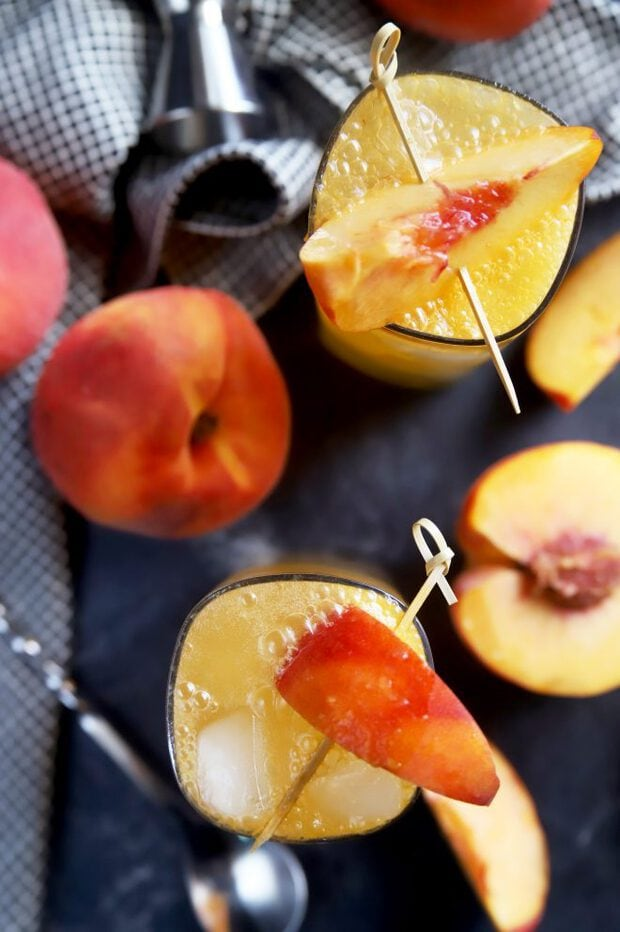 Peaches in cocktails with whiskey and ginger