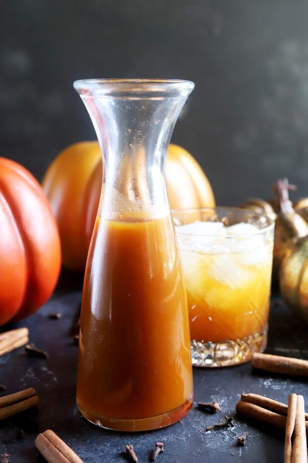 Pumpkin syrup and cocktail with pumpkins