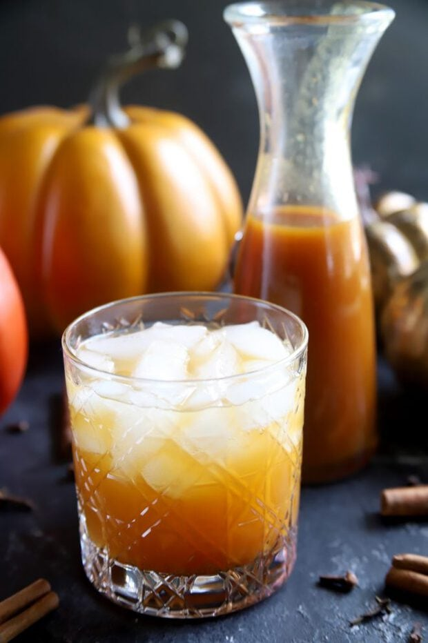 Pumpkin cocktail for fall with pumpkins