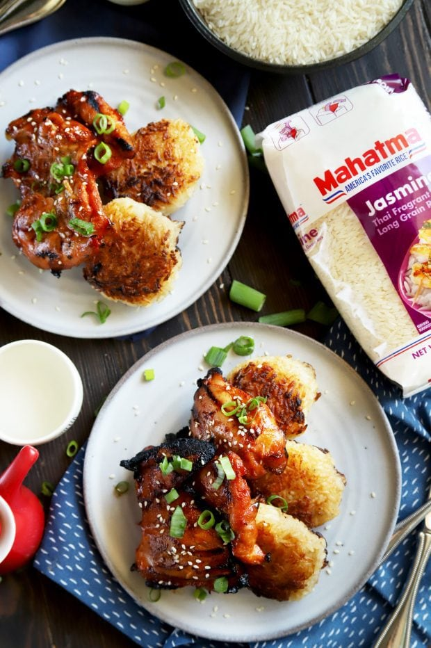 Overhead shot of spicy Korean chicken thighs on plates