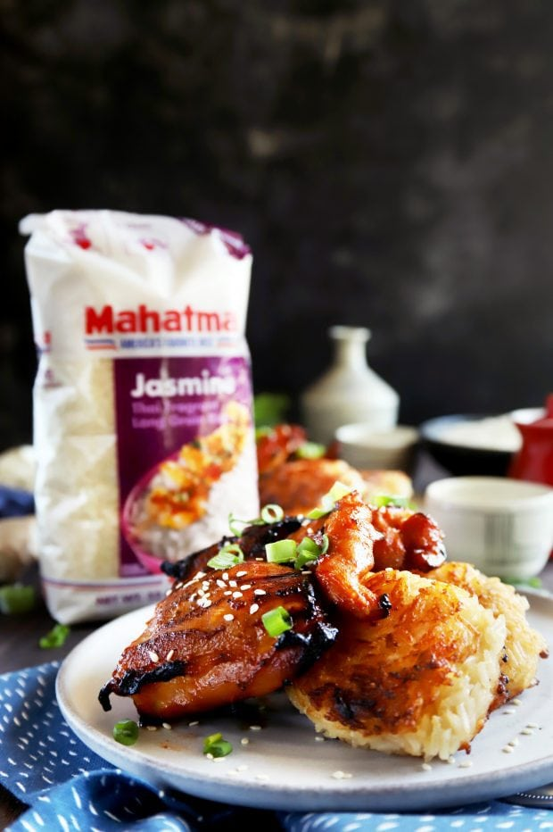Straight on photo of chicken over rice cakes
