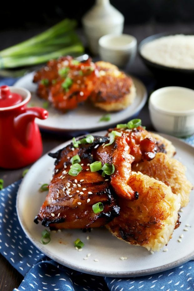 Grilled chicken thighs over rice cakes