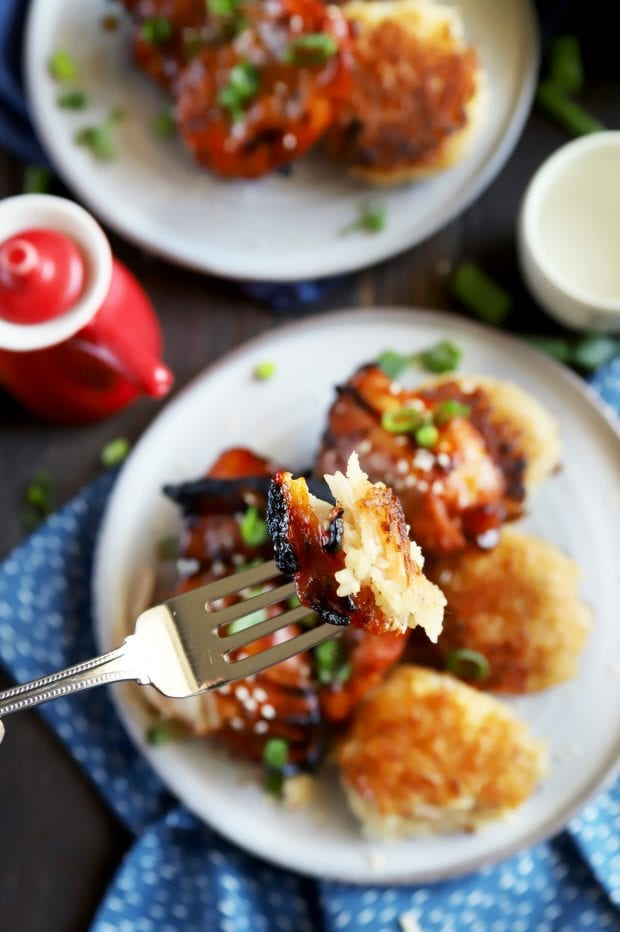 Bite of chicken and rice on a fork