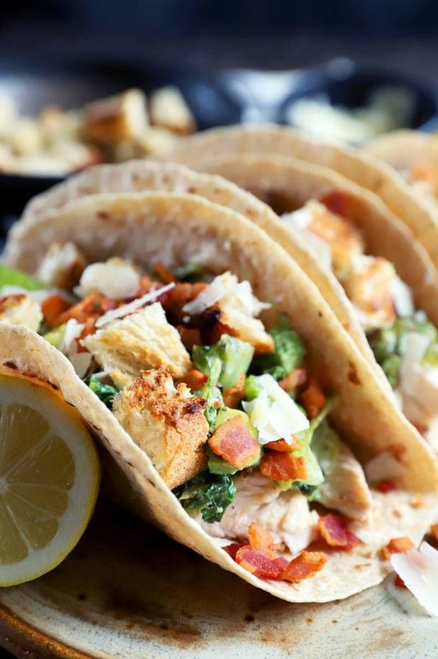 Side photograph of caesar salad tacos