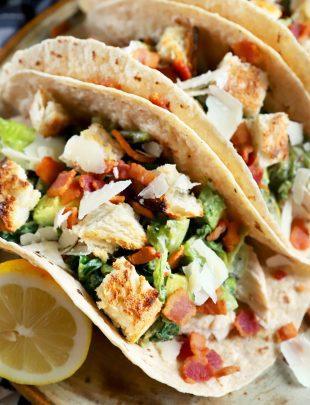 Thumbnail image of charred caesar salad chicken tacos