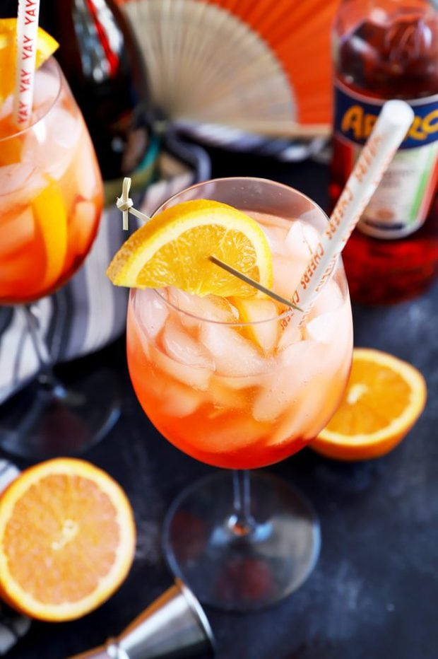 Aperol Spritz cocktail with a straw in it