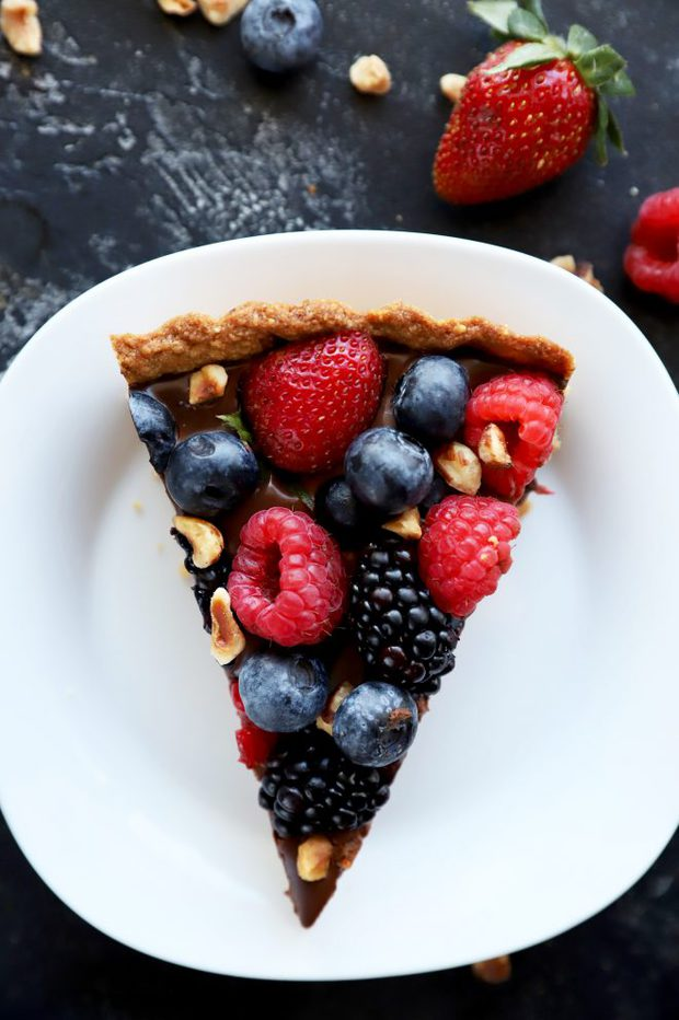 One slice of chocolate tart with hazelnut crust