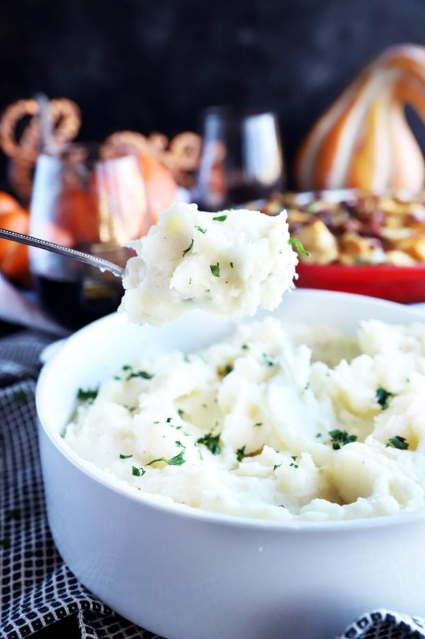Spooning out mashed potatoes