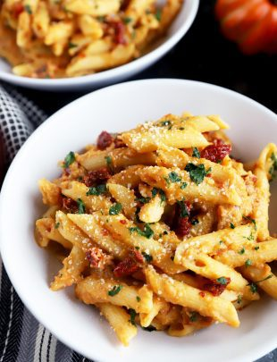 Bowl full of pumpkin pasta with sun-dried tomatoes