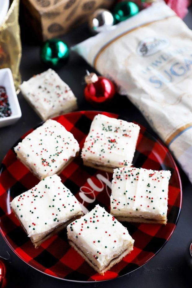 Chewy cookie bars with frosting on a plate