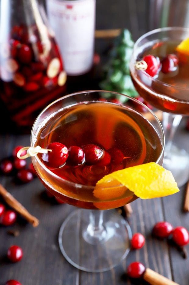 Cranberry spice Manhattan cocktail in a coupe glass photo