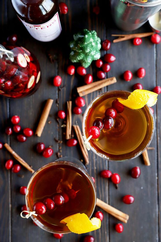 Overhead photo of holiday cocktails with cranberry and cinnamon