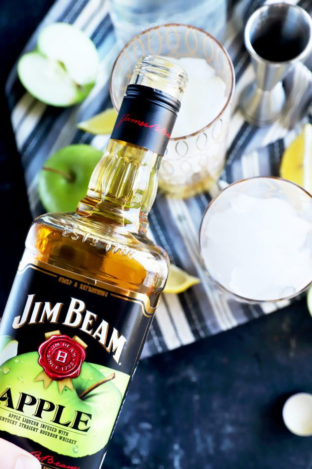 Pouring Jim Beam Apple into a cocktail glass