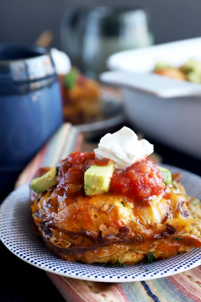 Side photo of Mexican breakfast bake with salsa and avocado
