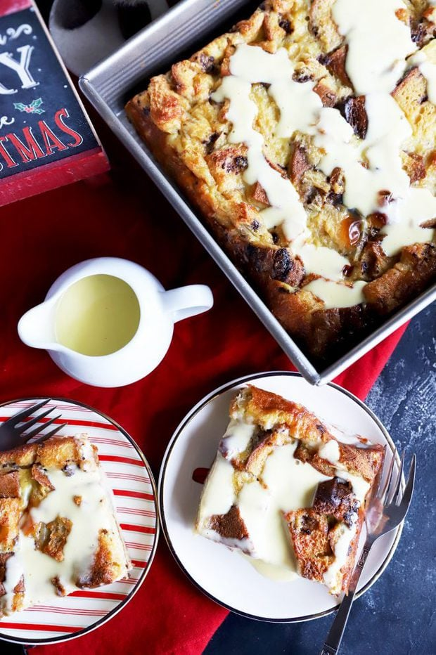 Overhead photo of slices of bread pudding with creme anglaise