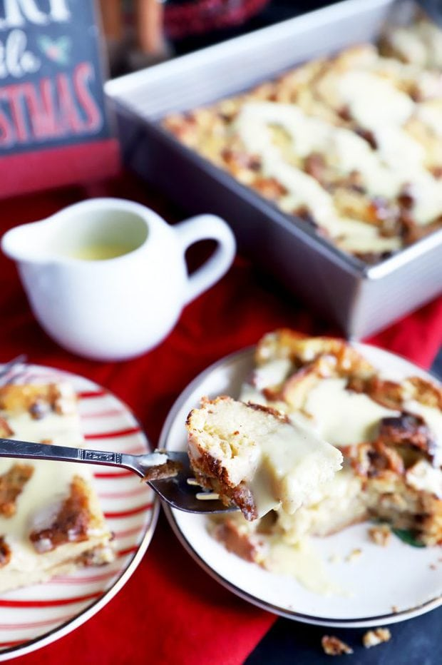 Photo of a fork with bread pudding and creme anglaise
