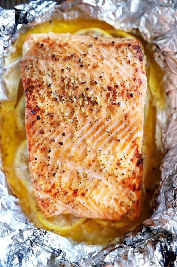 Baked salmon over lemon slices image