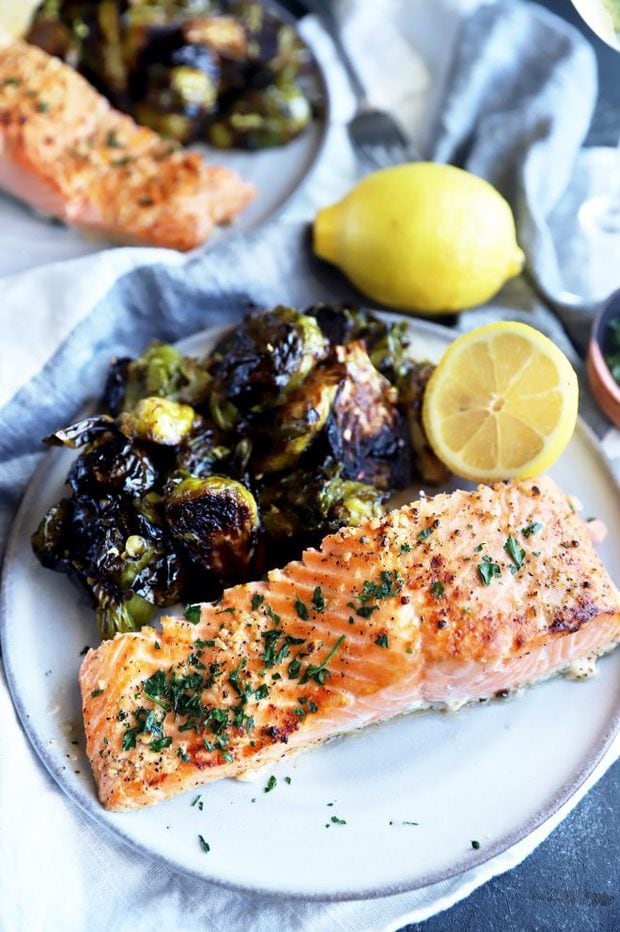 Salmon filet on a plate with brussels sprouts