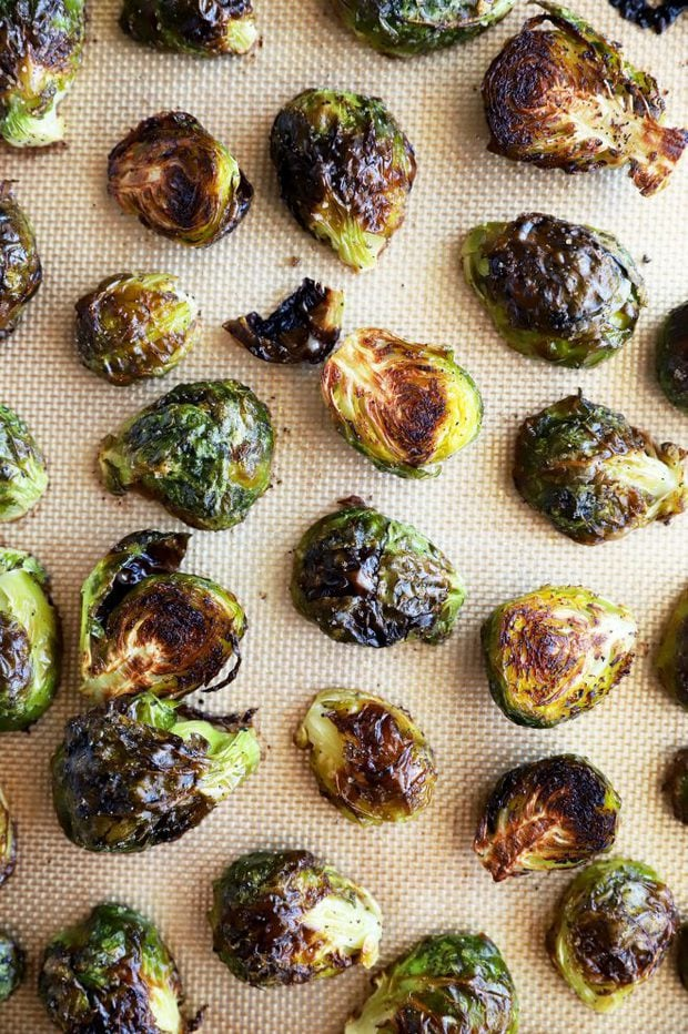 Cooked brussels sprouts on a baking sheet