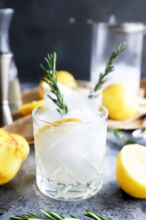 Cocktail in a glass with rosemary and pear photo