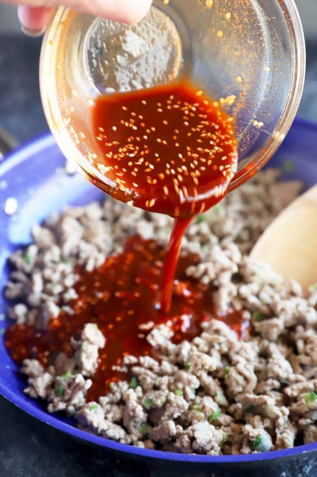 Pouring Korean sauce onto meat photo