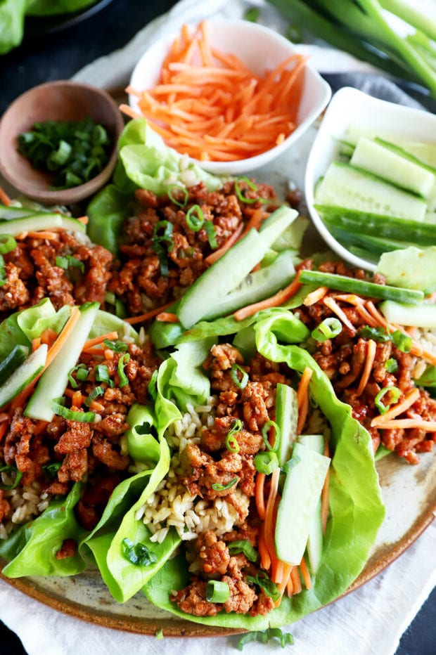 Lettuce wraps on a plate with toppings image