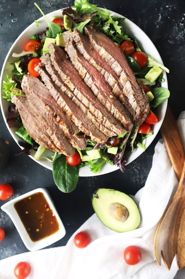 Steak salad image with dressing