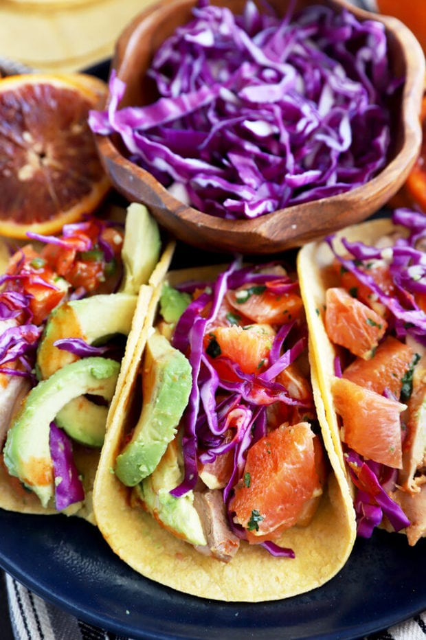 Blood orange chicken tacos on a plate image