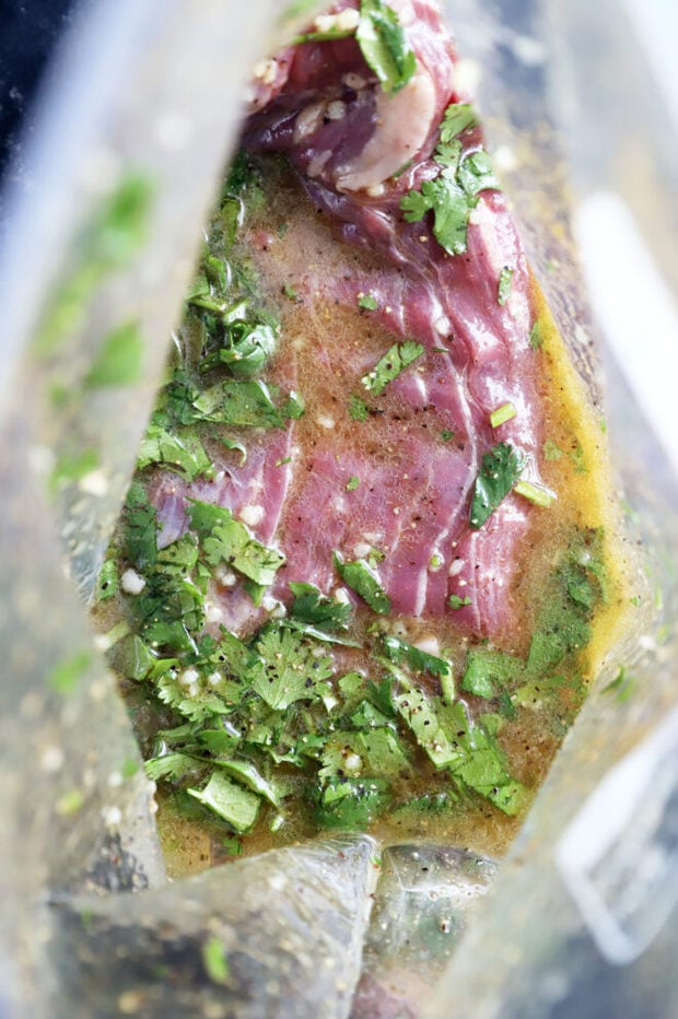 Mojo steak in marinade photo