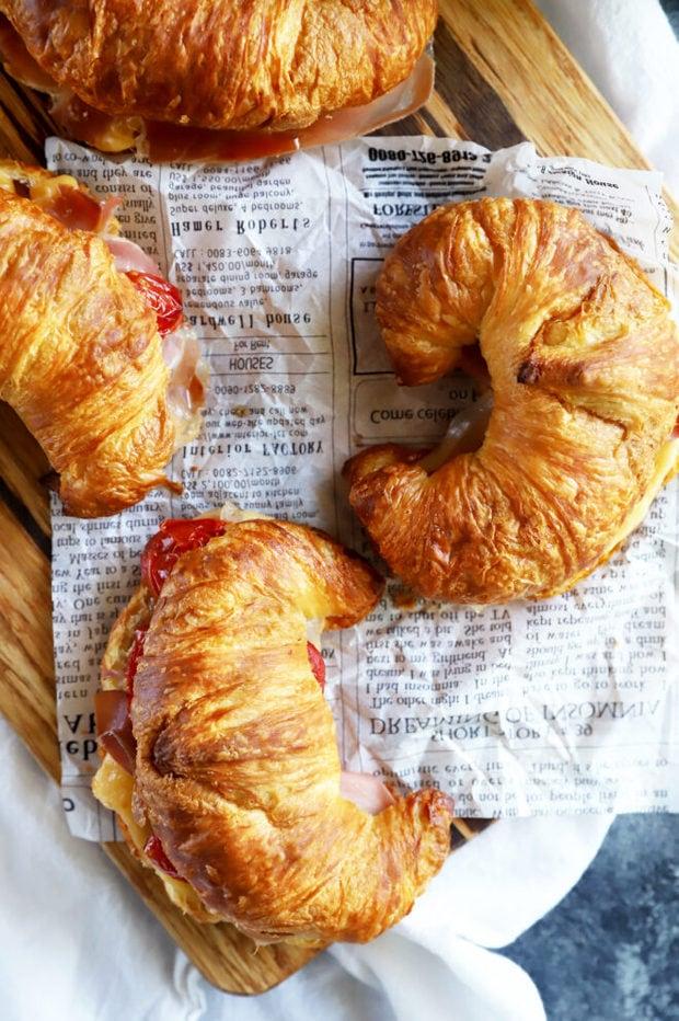 Overhead photo of breakfast croissant sandwiches