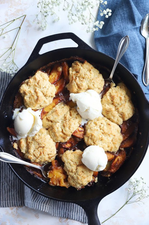 Peaches with ice cream and biscuits image
