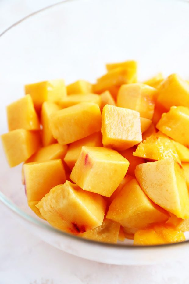 Peeled and chopped peaches in a bowl photo