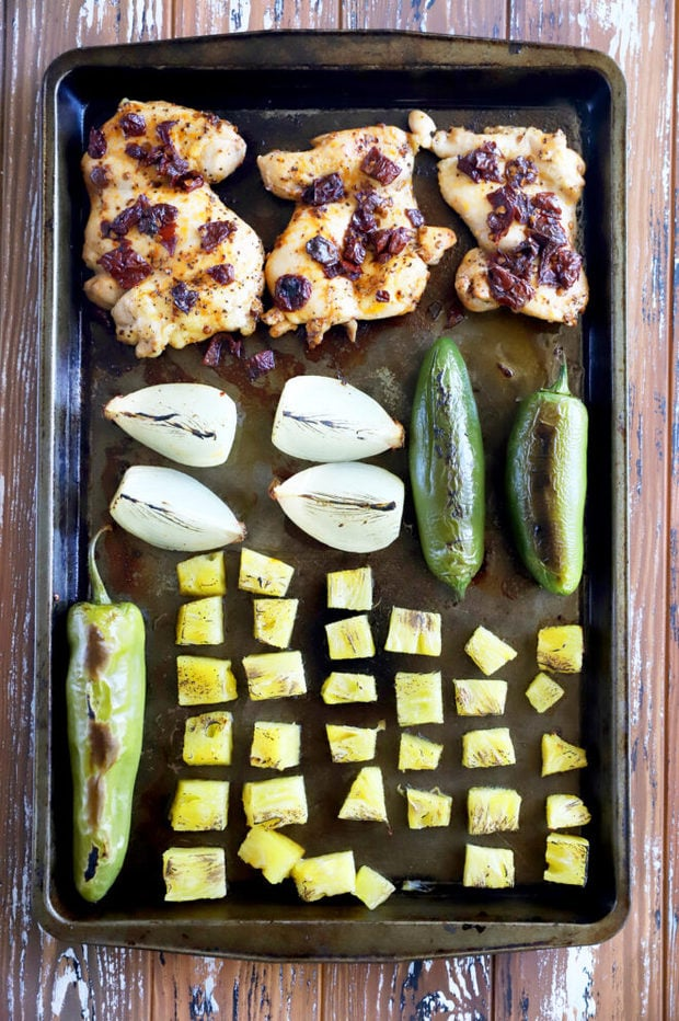Roasted vegetables and chicken on sheet pan image