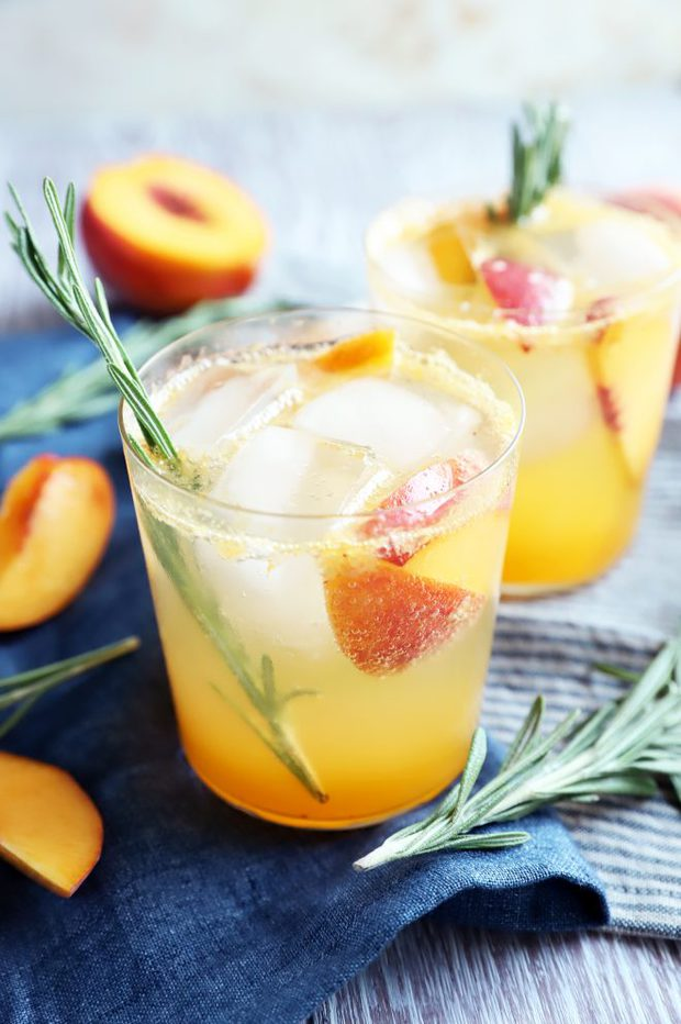 Side photo of peach mocktail in glasses