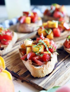 Summer tomato peach bruschetta on platter photo