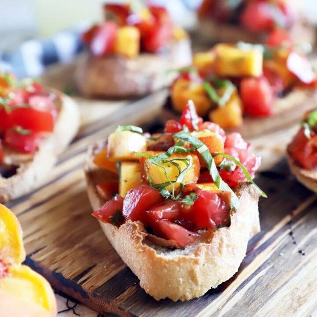 Summer tomato peach bruschetta on platter photo