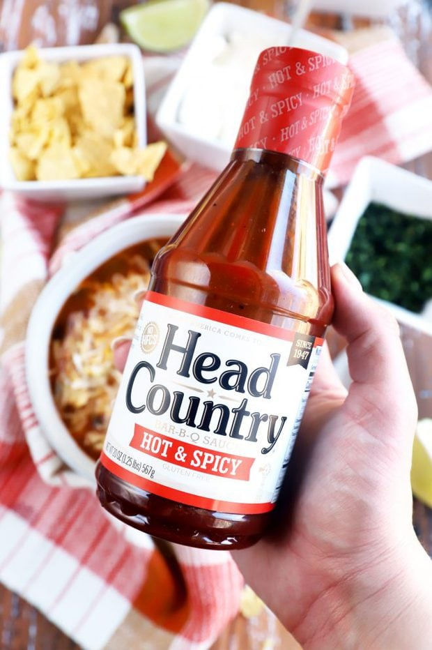 hand holding head country bottle image