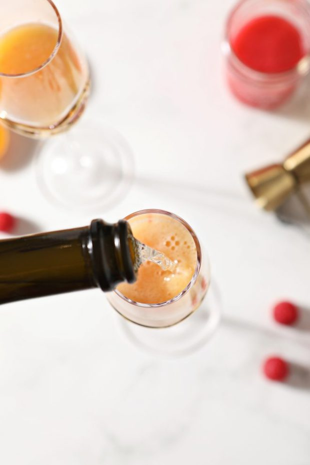 champagne being poured into glass photo