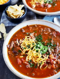 Bowl full of chili with steak image